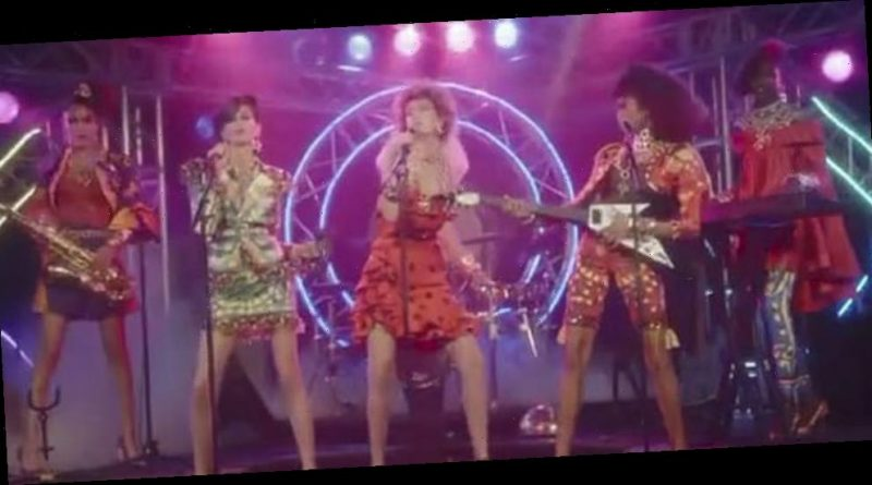 Bella Hadid Rocks Out In Moschino's 'Moschinorama' Video With Sister Gigi Hadid
