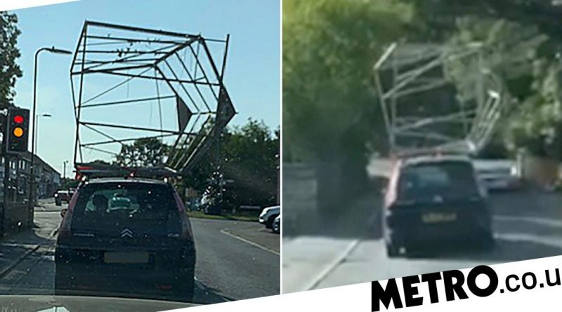 Driver takes to the streets with entire greenhouse strapped to roof